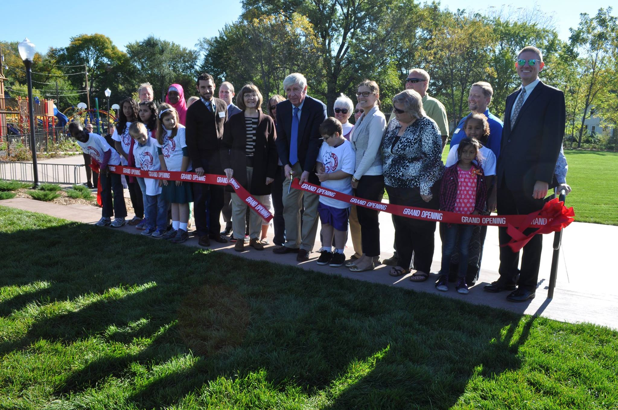 Group cutting a ribbon at Cottageville Park