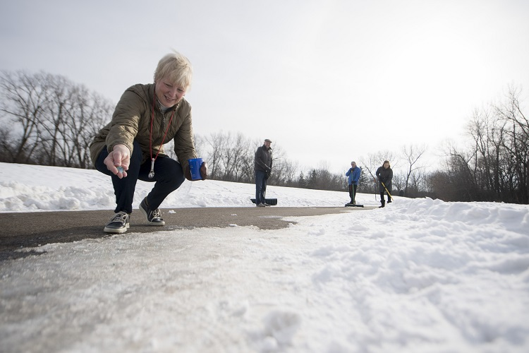Woman putting down small amount of road salt