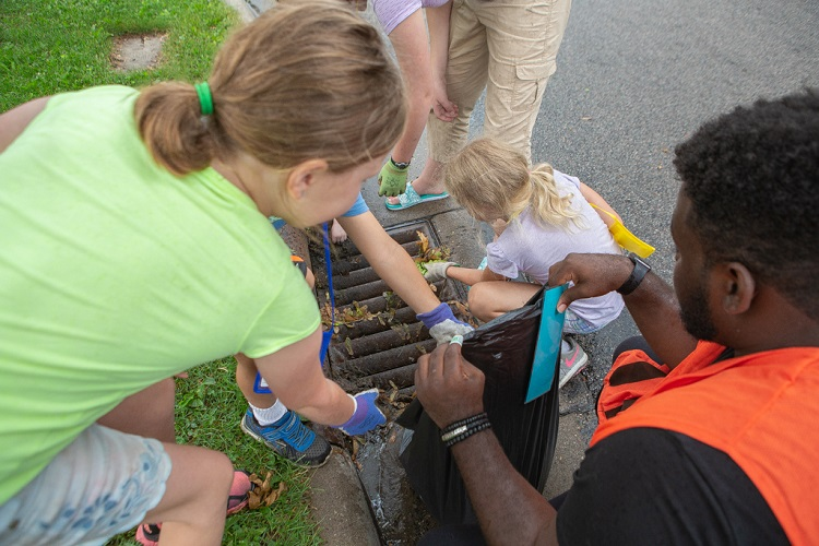 Kids cleaning a storm drain