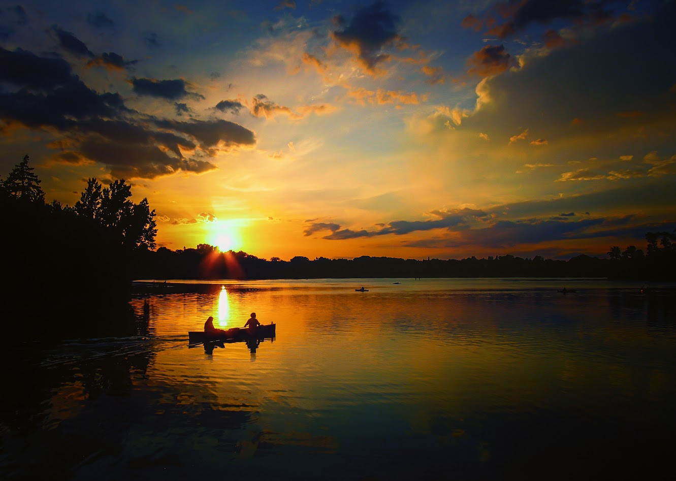 Mike Joslin's photo of two people canoeing at sunset