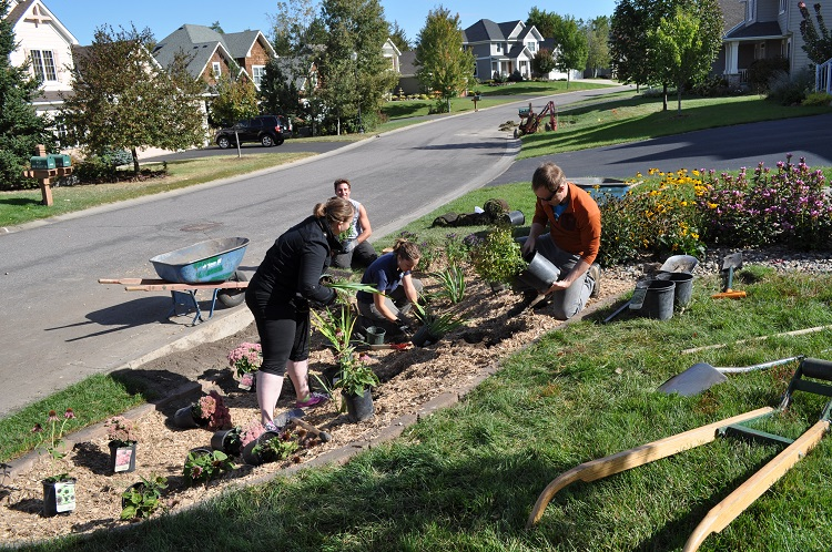 Group of people planting rain garden