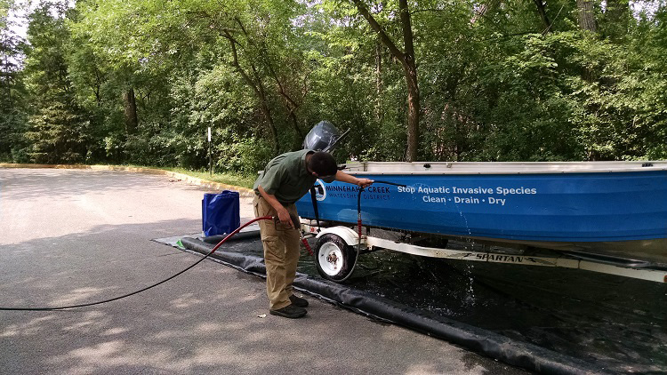 Man cleaning an MCWD boat