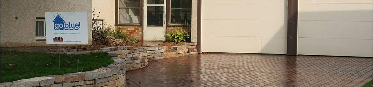 A driveway with pervious pavement, allowing water to infiltrate into the soil.