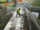 Person jackhammering during construction of weir